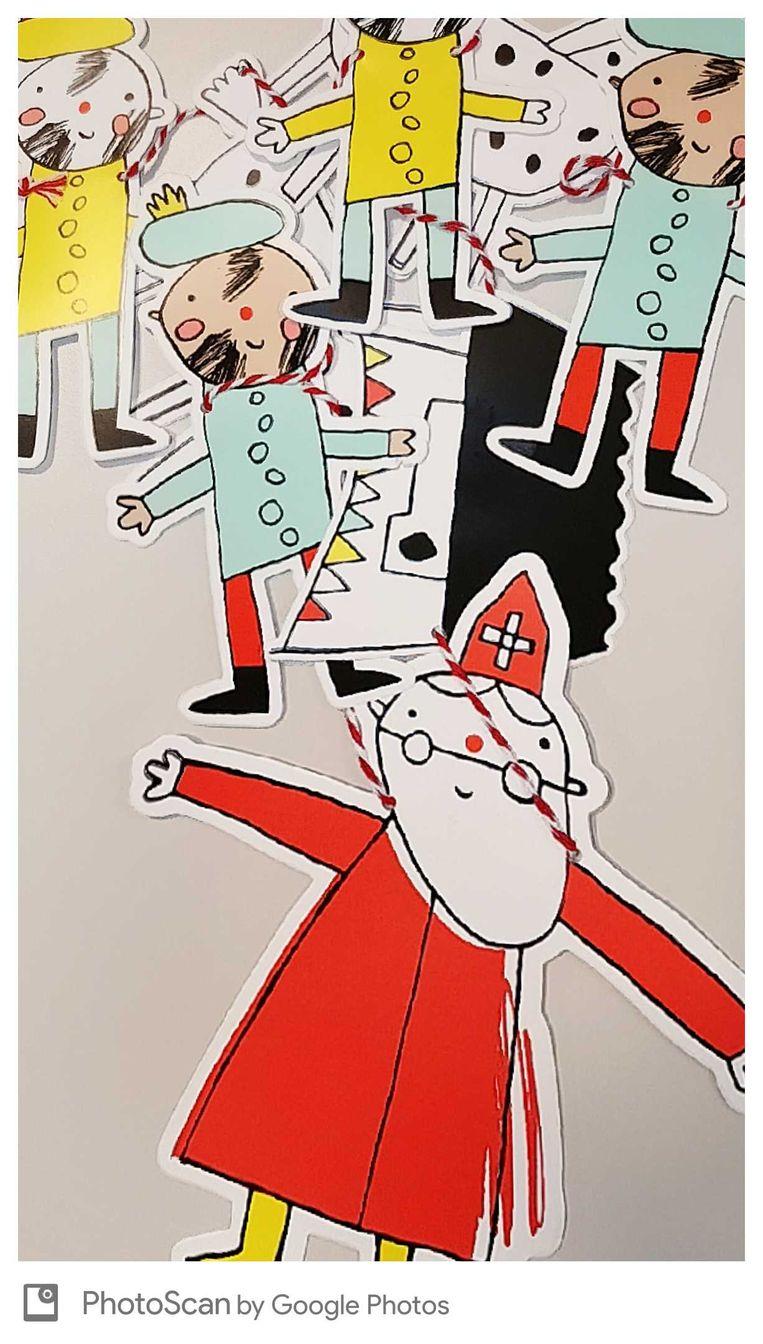Sinterklaas en zijn knechten Beeld Trouw