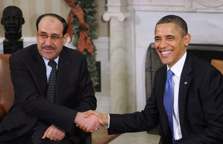 Maliki (links) en Obama in 2011. Beeld EPA