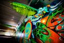 De Superman-figuur van Dr. Morph vliegt over Lempke, een Eindhovens graffiti-icoon.