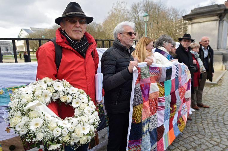Op 11 maart, de Dag van het Slachtoffer, gingen slachtoffers van de aanslagen in Brussel en van de Bende van Nijvel in Brussel de straat op.  Beeld Belga