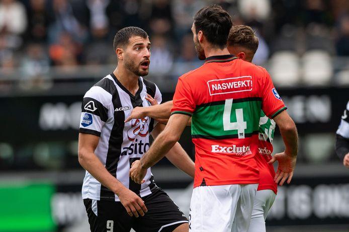 Sinan Bakis krijgt het aan de stok met Ivan Marquez van NEC en kan inrukken.