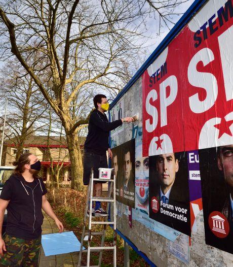 Romantiek van nijvere plakploegen in verkiezingstijd verdwijnt uit het straatbeeld: 'Het is een sport'