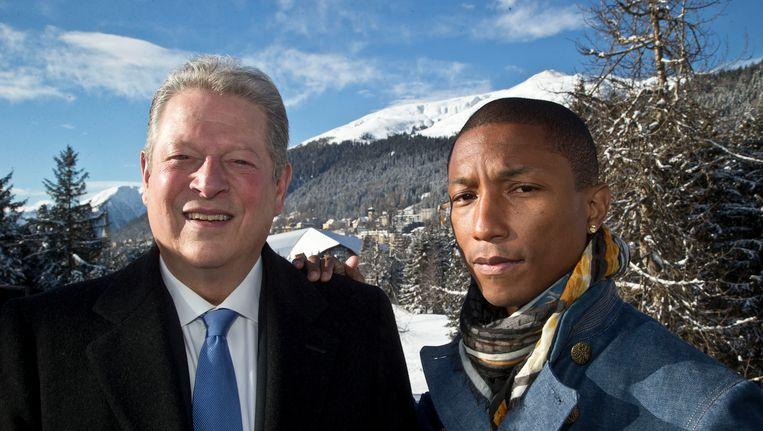 Al Gore en Pharrell Williams in het Zwitserse Davos bij het World Economic Forum. Beeld AP