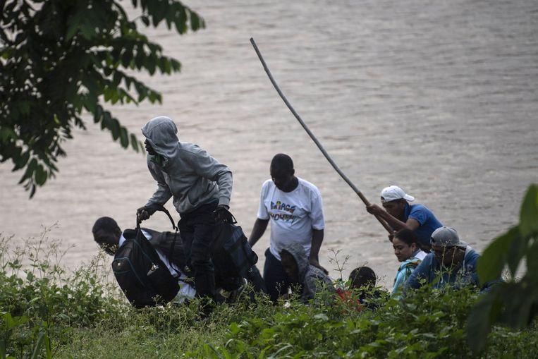Migranten komen aan in Mexico. Beeld AFP