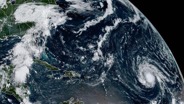 Orkaan Irma (rechtsonder in beeld) hier te zien vanuit de ruimte. Beeld afp