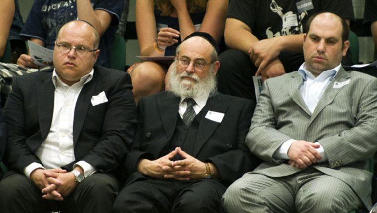 Afgevaardigden van de Joodse gemeenschap, waaronder Ronnie Eisenmann (L) van de Joodse Gemeenschap Amsterdam. © ANP Beeld