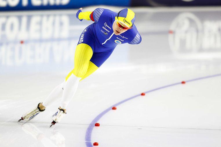 Nils van der Poel tijdens zijn winnende race op de 10.000 meter tijdens de WK in Heerenveen. Beeld ANP
