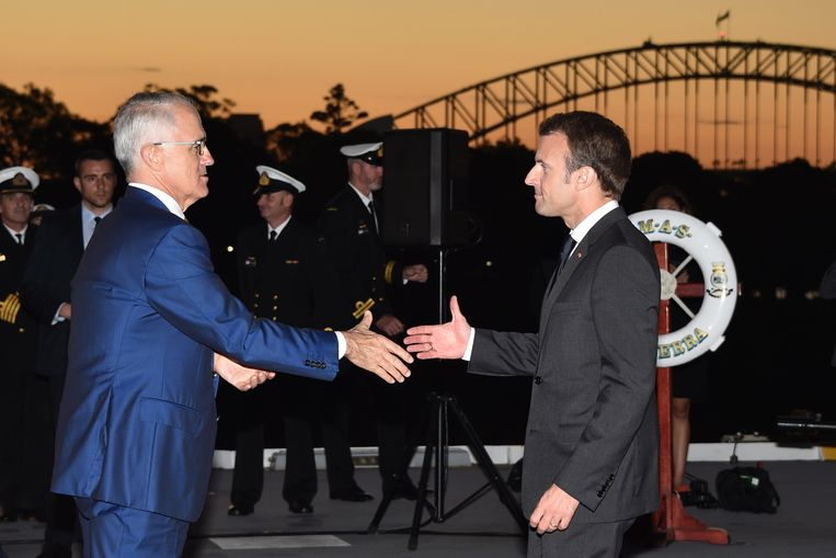 Macron (rechts) en Turnbull. Beeld Getty Images