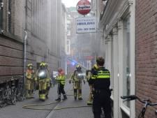 Brand in keuken van restaurant Himalayan in Haagse binnenstad, één gewonde