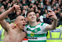 Kieran Tierney met Scott Brown (links).