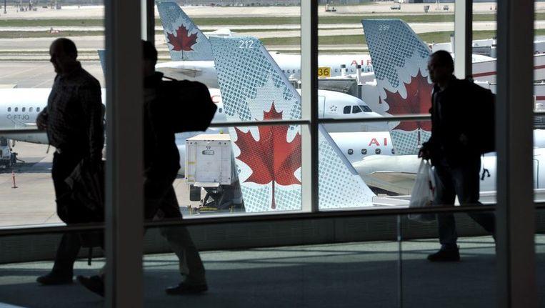 Toestellen van Air Canada op de luchthaven van Toronto. Beeld reuters