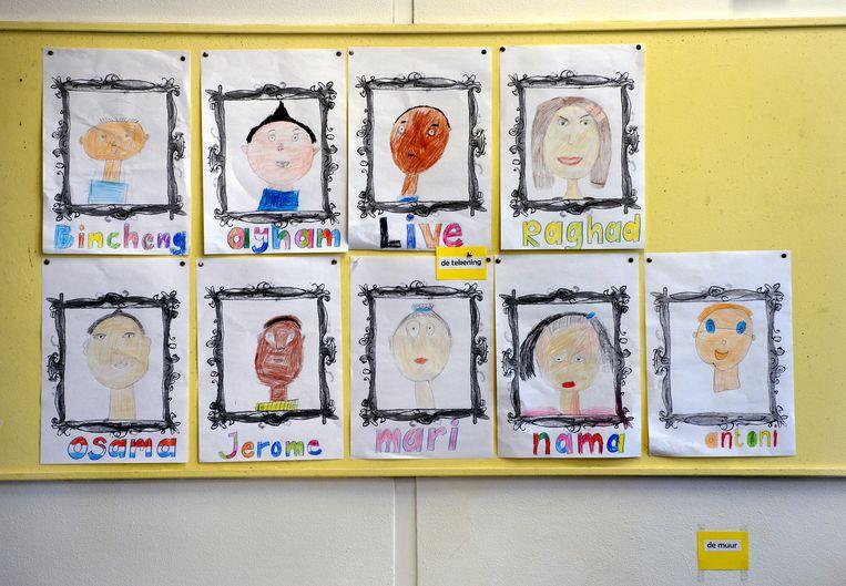 Zelfportretten die de vluchtelingenkinderen hebben gemaakt. Beeld Marcel van den Bergh / de Volkskrant