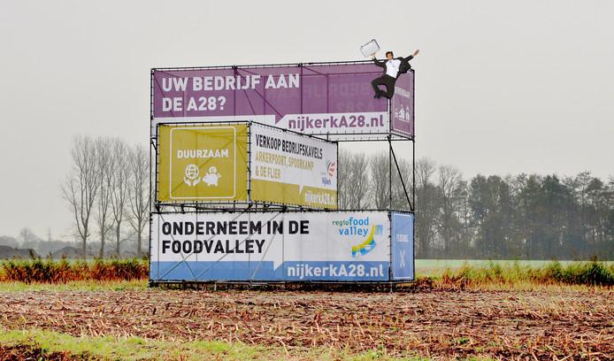 Een promotiebord voor bedrijventerreinen Arkerpoort, Spoorkamp en De Flier.