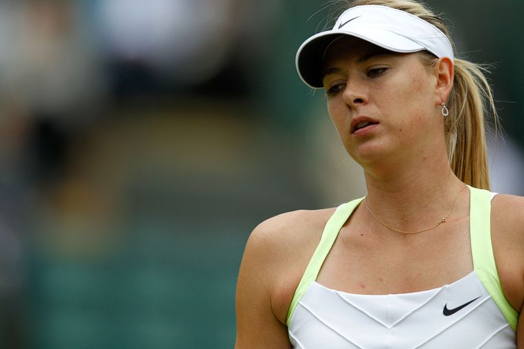 Voor Maria Sharapova is Wimbledon voorbij. Beeld GETTY
