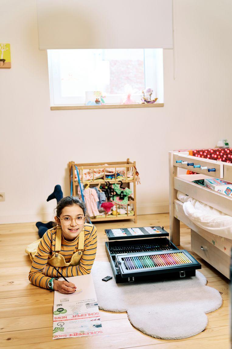 Gloria speelt graag met Lego en poppen, of ze tekent. Beeld Joris Casaer