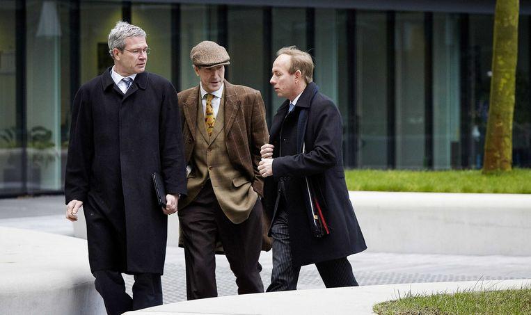 Elbert Dijkgraaf (links), met SGP-voorlichter Menno de Bruyne en partijleider Kees van der Staaij Beeld anp
