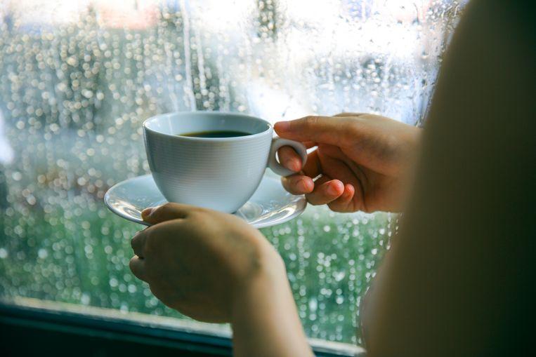 woman-drinking-coffee-by-window-on-rainy-day.jpg