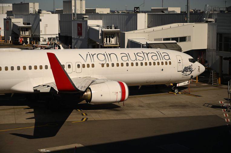 Een vliegtuig van Virgin Australia op de luchthaven van Sydney. Beeld AFP