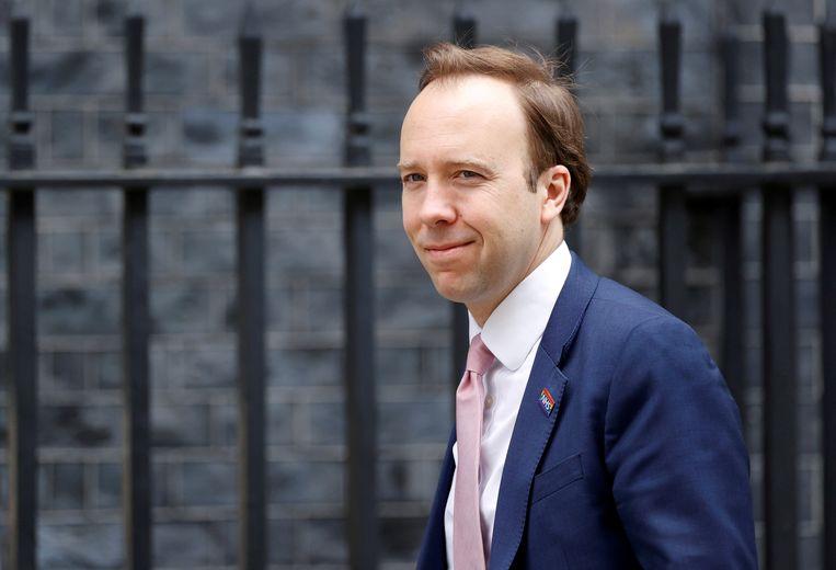 Zorgminister Matt Hancock arriveert in Downing Street voor een overleg. Beeld REUTERS