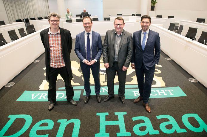 De leiders van de nieuwe coalitie (vlnr): Arjen Kapteijns (GroenLinks), Boudewijn Revis (VVD), Richard de Mos (Groep de Mos) en Robert van Asten (D66).