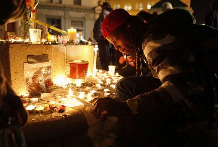 Kaarsen voor de slachtoffers. © AP