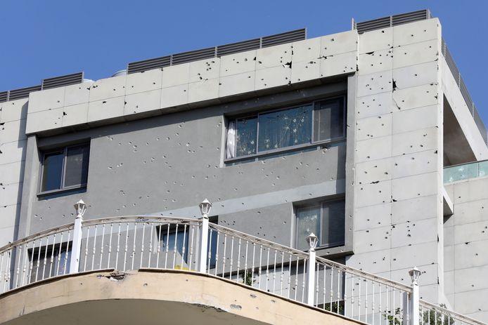 Des impacts d'armes à feu sont visibles sur un bâtiment après une fusillade, à Beyrouth, au Liban, le 14 octobre 2021.