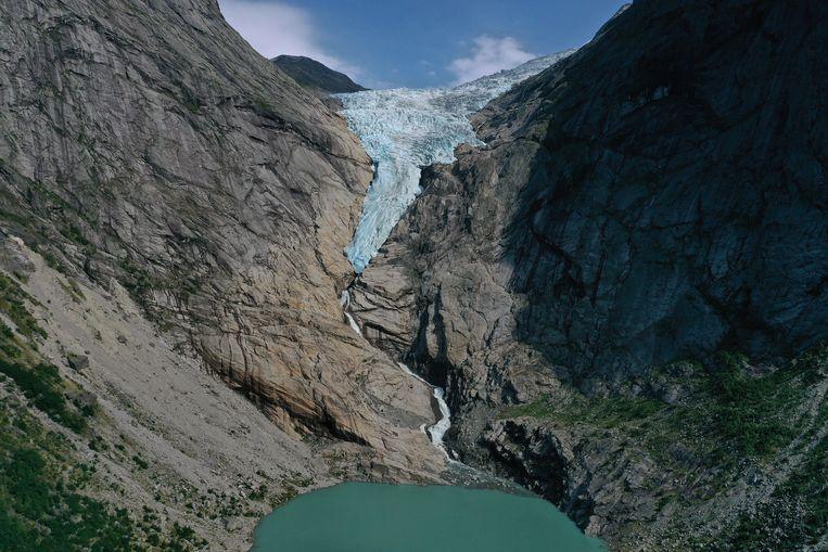 Smeltende gletsjer in Noorwegen. De temperatuur van de aarde is nog nooit zo snel gestegen als nu. Beeld Getty Images