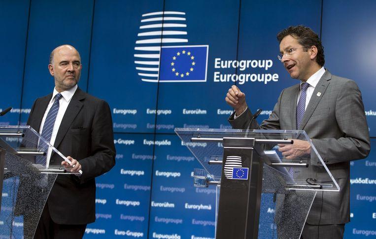 Europees Commissaris Pierre Moscovici en eurogroepvoorzitter Jeroen Dijsselbloem. Beeld REUTERS