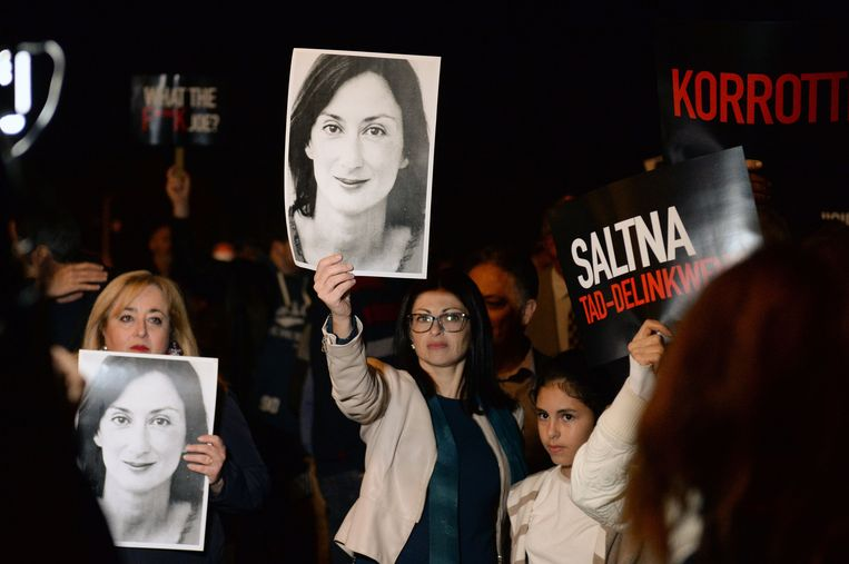Protesters hold up placards and pictures of the late journalist Daphne Caruana Galizia as they gather outside the prime minister's office in Valletta, Malta on November 20, 2019, the day Maltese businessman Yorgen Fenech, who is believed to be the mastermind behind her assassination, was detained on his yacht after he tried to leave Malta. - Malta on November 20 arrested a tycoon in connection with the murder of journalist Daphne Caruana Galizia, the day after an alleged middleman was offered a pardon to identify the mastermind behind the killing. Maltese national Yorgen Fenech was detained on his yacht at dawn as he tried to leave Malta, in the latest development in the long-running case that has raised questions about the rule of law in Malta. (Photo by Matthew Mirabelli / AFP)