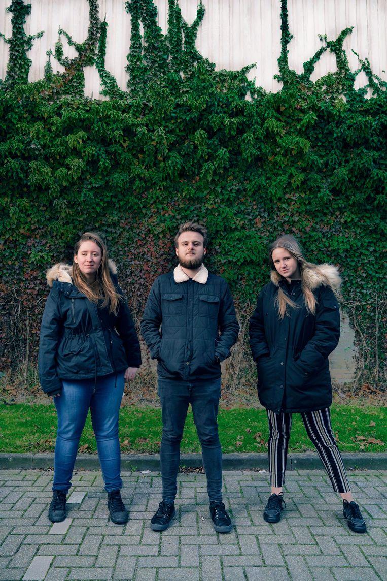 Joëlle, met rechts haar halfbroer Noah en haar zus Chenoa, alle drie kind van donor E19. Beeld Claudia Kamergorodski
