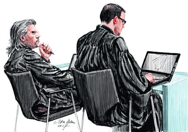 Aydin C. (links) en zijn advocaat Robert Malewicz in de extra beveiligde rechtbank in Amsterdam-Osdorp.