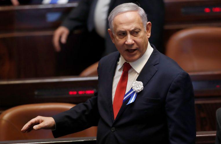 Premier Netanyahu begin deze maand bij de openingszitting van het nieuwe parlement, waarin zijn Likoed-partij sinds de verkiezingen van vorige maand 32 van de 120 zetels bezet. Netanyahu gaf maandag zijn pogingen op een nieuwe regering te vormen. Beeld EPA