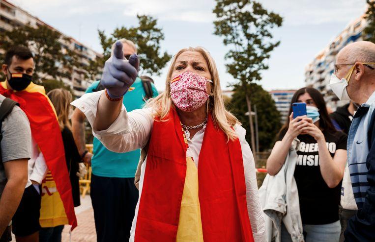 In Madrid werd vrijdag geprotesteerd tegen het coronabeleid van de Spaanse regering. Beeld AFP