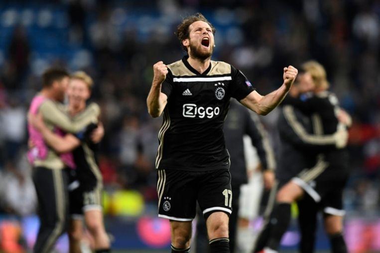 Daley Blind viert de winst tegen Real Madrid na de gewonnen Champions League wedstrijd.  Beeld AFP