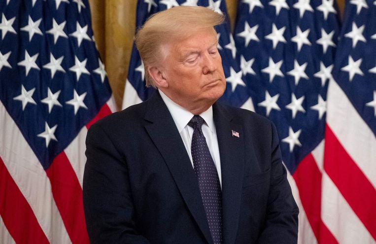 De Amerikaanse ex-president Donald Trump staat onder druk om zijn belastingsaangifte in te dienen.  Beeld AFP