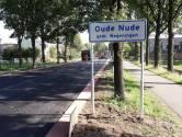 Blij met plaatsnaambord Ouwe Nu
