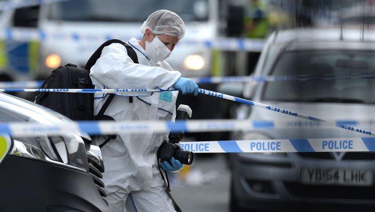 Onderzoek op de plek waar de aanval op het parlementslid plaatsvond. Beeld afp