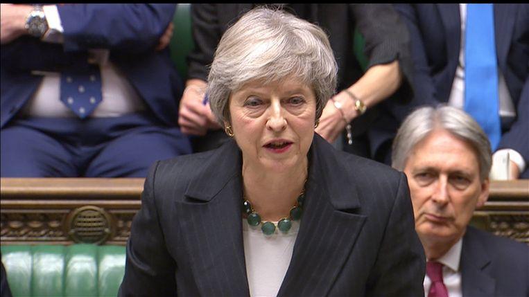 Eerste minister Theresa May verdedigde haar deal vanmiddag in het Britse Lagerhuis. Beeld REUTERS