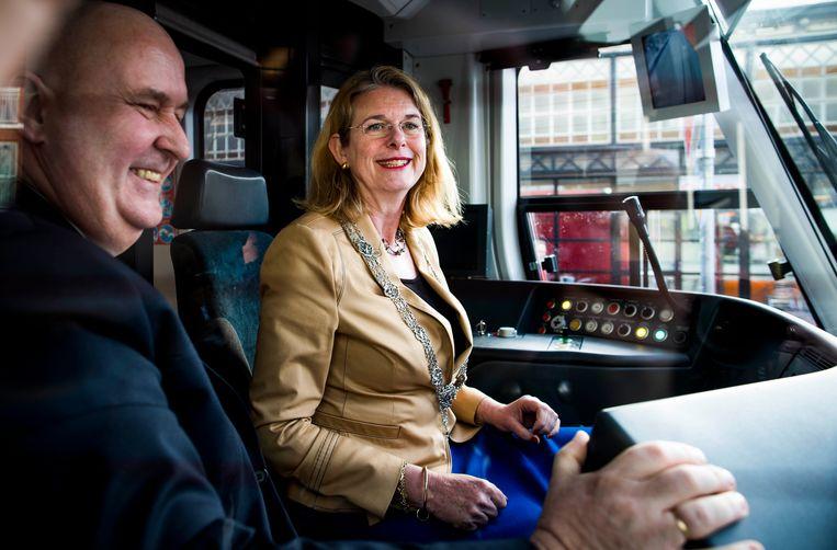 Pauline Krikke tijdens een werkbezoek in een tram. Beeld Freek van den Bergh