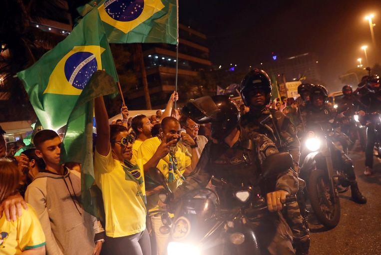 Aanhangers van de extreem-rechtse Jair Bolsonaro in Rio de Janeiro. Beeld REUTERS