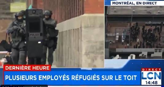 Politie bij het kantoor van Ubisoft (rechts) en tientallen werknemers hebben zich op het dak van het kantoor in Montreal verzameld.
