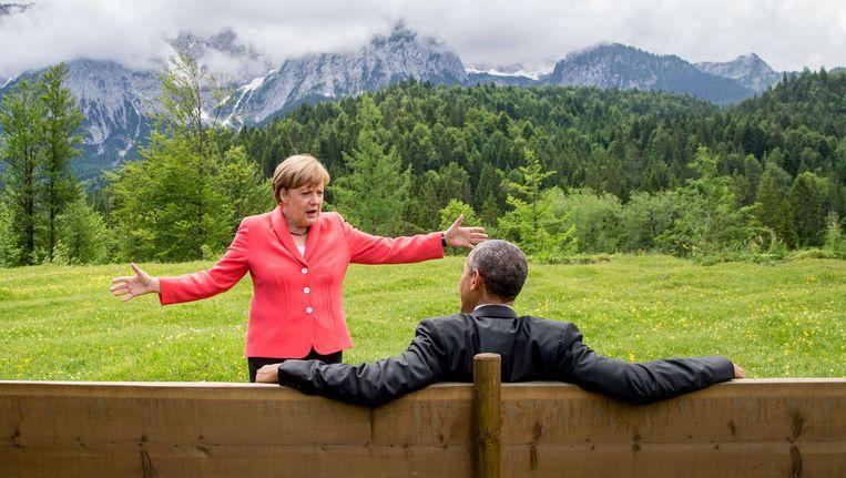 Angela Merkel en Barack Obama tijdens de G7-bijeenkomst afgelopen maandag. Beeld afp