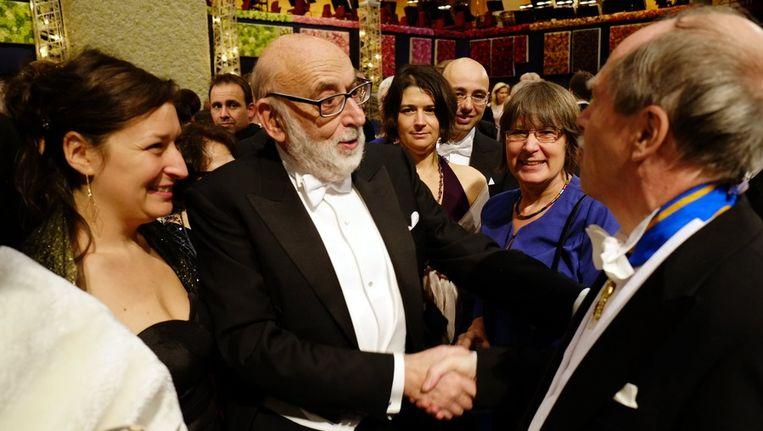 François Englert (midden) tijdens de ceremonie deze middag. Beeld BELGA