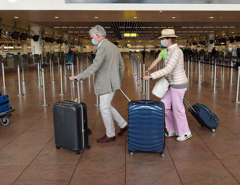 Passagiers op Brussels Airport. Brussels Airlines hervat maandag de vluchten naar de VS. Beeld Photo News