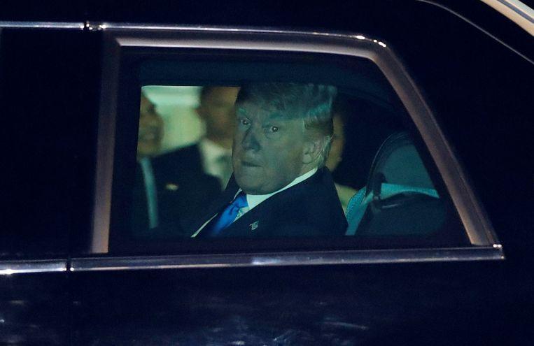 Donald Trump komt aan in Singapore.  Beeld REUTERS