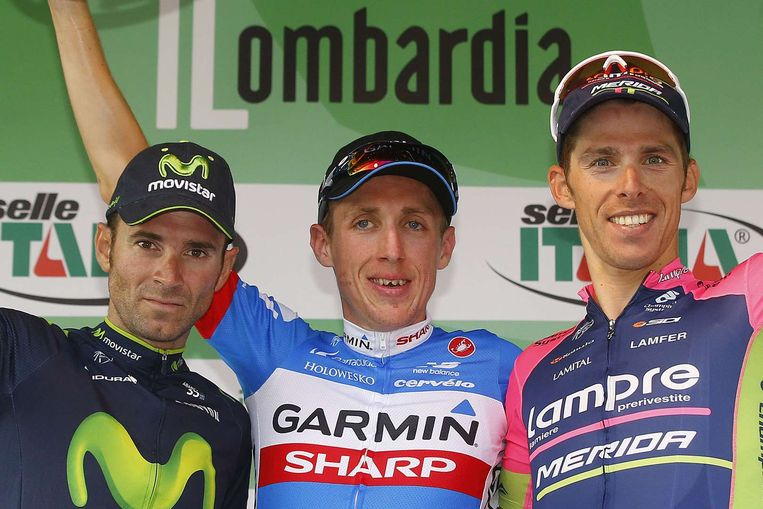 Het podium met naast winnaar Martin ook Valverde (l) en Costa (r) Beeld AFP