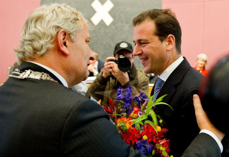 Asscher in 2012 bij zijn afscheid als wethouder in Amsterdam, met burgemeester Van der Laan (L) Beeld ANP