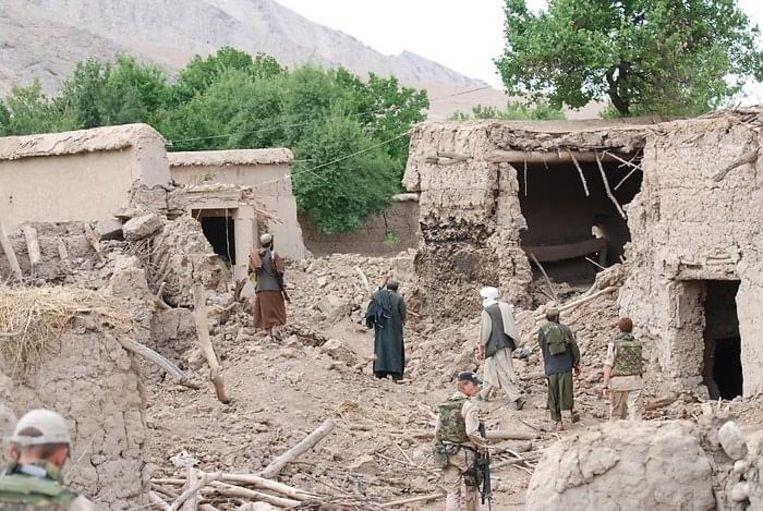 Verwoeste huizen na de zogenoemde Slag om Chora in juni 2007 in de Afghaanse provincie Uruzgan. De Nederlandse militair Oscar van der Ven maakte deze foto kort na de gevechten. Beeld Oscar van der Ven