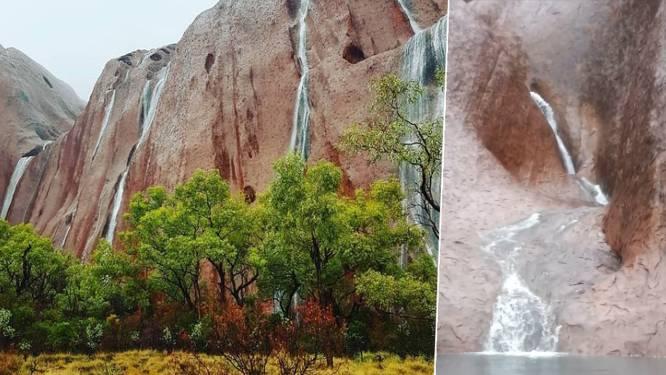 Slechts enkele toeristen kunnen zien hoe regen natuurwonder Uluru transformeert