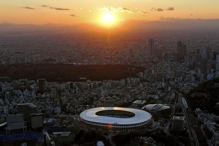 Het nieuwe national stadion, het hart van de Olympische Spelen in Tokio.  Beeld REUTERS